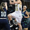 "Monarch High's Jordan Eisler (40) shoots over Thunder Ridge High's Reana Kaminsky (10) during their game at the Denver Coliseum on Saturday March 3, 2012.<br /> Photo by Paul Aiken / The Daily Camera /  <a href=""http://www.bocopreps.com"">http://www.bocopreps.com</a>"