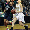 "Monarch High's Brenna Stimas (12) drives to the hoop againstThunder Ridge High's Brianna Throop (14) during their game at the Denver Coliseum on Saturday March 3, 2012.<br /> Photo by Paul Aiken / The Daily Camera /  <a href=""http://www.bocopreps.com"">http://www.bocopreps.com</a>"