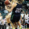 "Monarch High's Raegen Rohn (15) runs over Thunder Ridge High's  Megan Yoney (20) during their game at the Denver Coliseum on Saturday March 3, 2012.<br /> Photo by Paul Aiken / The Daily Camera /  <a href=""http://www.bocopreps.com"">http://www.bocopreps.com</a>"