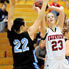 Fairview's Hanna Hyde (R) looks to shoot while being guarded by Mountain Range's Tori Craig (L) during their basketball game at Fairview High School in Boulder, Colorado March 1, 2011.  CAMERA/Mark Leffingwell