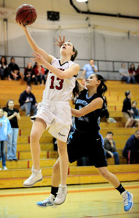 Fairview's Nina Ball (left) shoots a layup while being pressured by Mountain Range's Kristen Ward (right) during their basketball game at Fairview High School in Boulder, Colorado March 1, 2011.  CAMERA/Mark Leffingwell