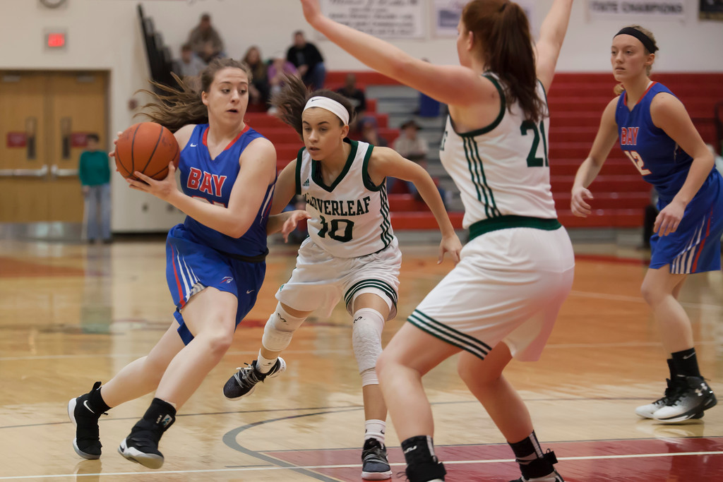 . Haley Andrejcak of Bay is undeterred by Cloverleaf defenders Cameron Tripp and McKenna Jordan. Jen Forbus -- The Morning Journal