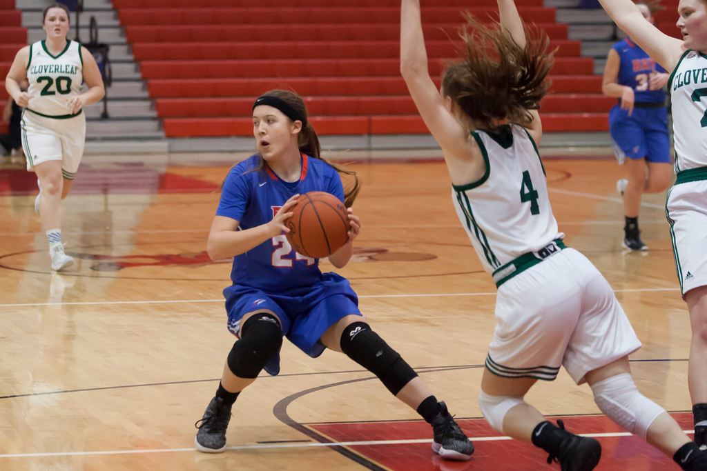 . Bay\'s Barbara Aldridge looks for help from her fellow Rockets as Cloverleaf\'s Jenna Oliver (4) blocks her path in the paint. Jen Forbus -- The Morning Journal