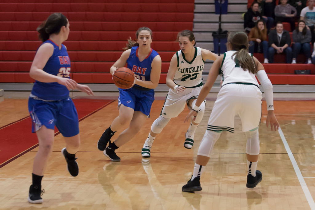 . Rocket Haley Andrejcak (right) brings the ball down court with Colt Helaina Limas matching her stride for stride. Jen Forbus -- The Morning Journal