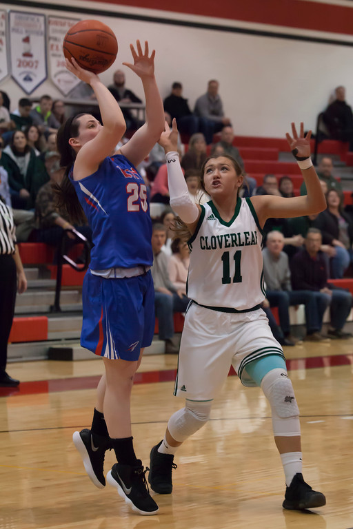 . Rocket Maddie Andrews pops a shot up before Cloverleaf\'s Bri Gallagher can close in. Jen Forbus -- The Morning Journal