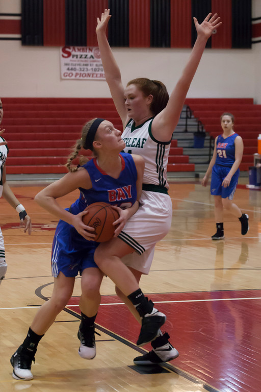 . Bay\'s Maddie Edgerly looks past Cloverleaf\'s McKenna Jordan to the basket. Jen Forbus -- The Morning Journal