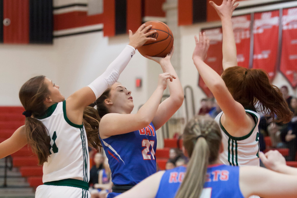 . Haley Andrejcak of Bay tries to push through the Cloverleaf defense for a shot. Jen Forbus -- The Morning Journal