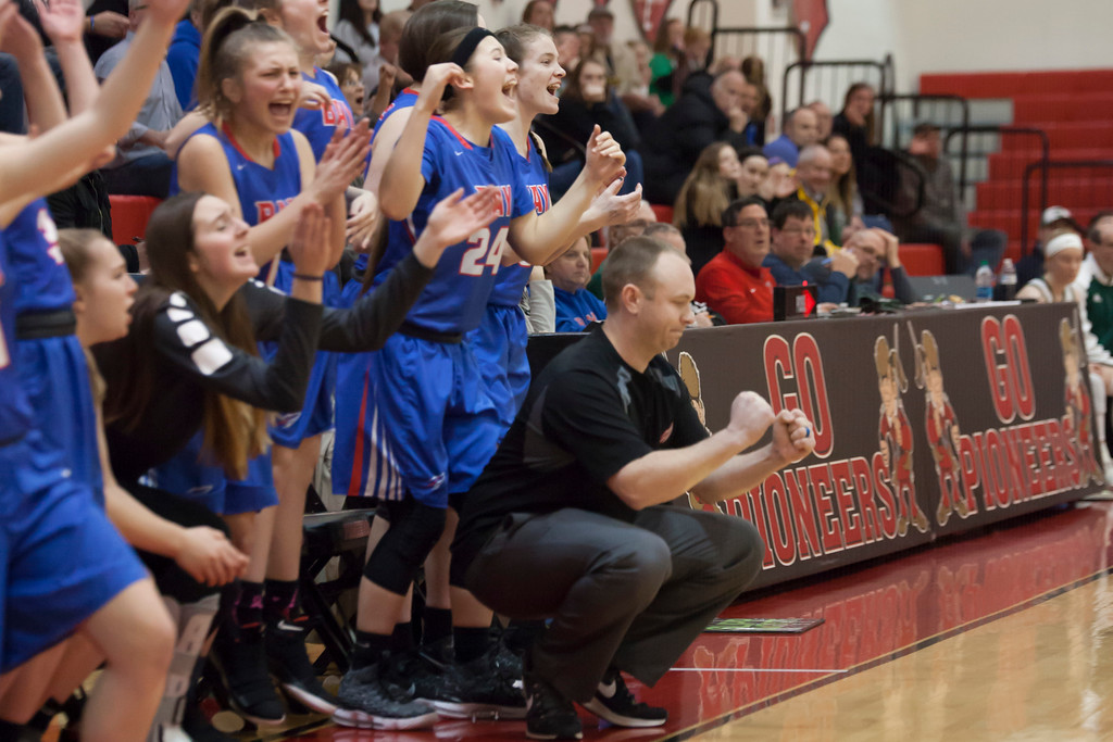 . 0374 - Bay head coach Brian Hill and the Rocket bench celebrate a three-point basket during the Division II District Finals game Thursday night against the Cloverleaf Colts. Jen Forbus -- The Morning Journal