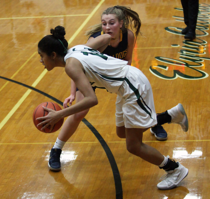 . Strongsville\'s Marnae Holland drives past Danielle Stevens of Olmsted Falls during the first quarter. Randy Meyers -- The Morning Journal