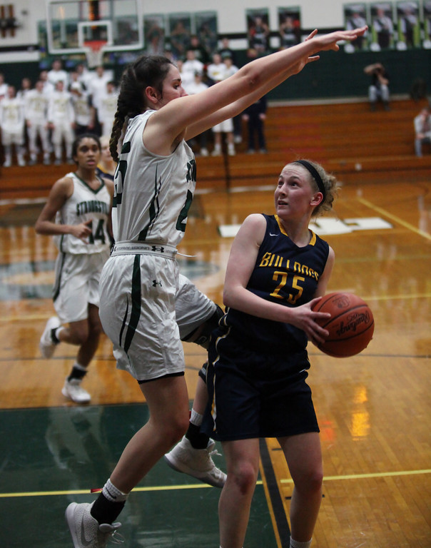 . Strongsville\'s Lindsey Thall defends Sarah Balfour of Olmsted Falls in the paint during the second quarter. Randy Meyers -- The Morning Journal
