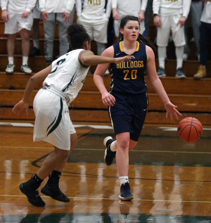 . Clare Kelly of Olmsted Falls brings the ball up court against the pressure applied by Drew Robinson of Strongsville. Randy Meyers -- The Morning Journal