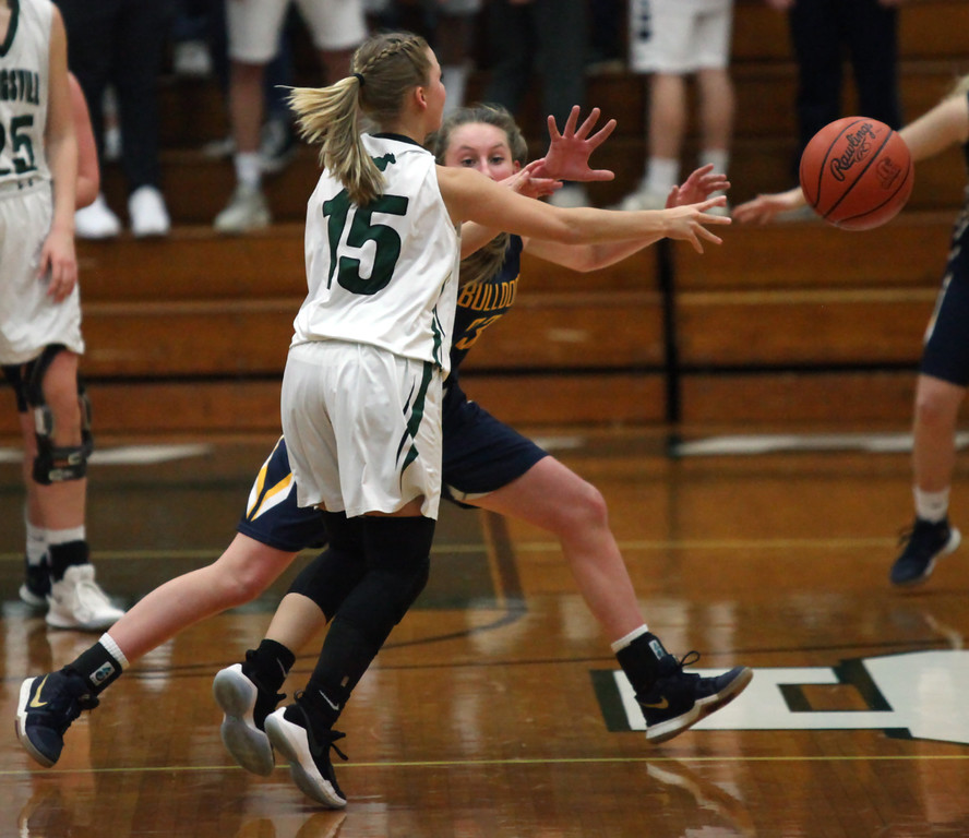 . Maddy Humbach of Strongsville passes around the defensive pressure applied by Lauren Galaska of Olmsted Falls. Randy Meyers -- The Morning Journal