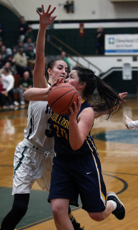 . Clare Kelly of Olmsted Falls drives against Reagan Bass of Strongsville during the third quarter. Randy Meyers -- The Morning Journal