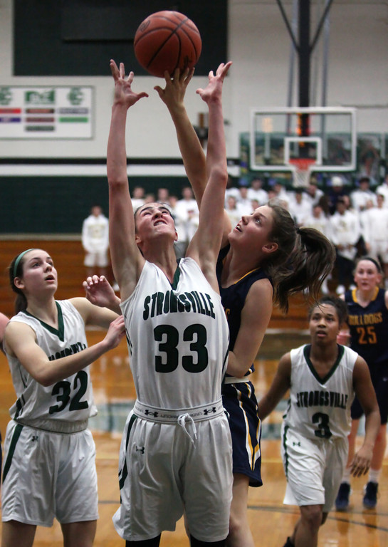 . trongsville\'s Reagan Bass battles Grace Simon of Olmsted Falls for a rebound during the second quarter. Randy Meyers -- The Morning Journal