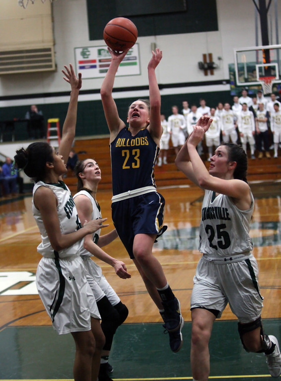 . Lauren Galaska of Olmsted Falls drives through three Strongsville defenders and scores during the second quarter. Randy Meyers -- The Morning Journal