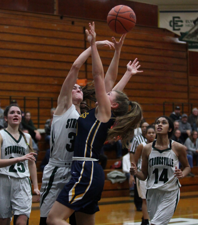 . Strongsville\'s Reagan Bass blocks the shot by Danielle Stevens of Olmsted Falls during the third quarter. Randy Meyers -- The Morning Journal