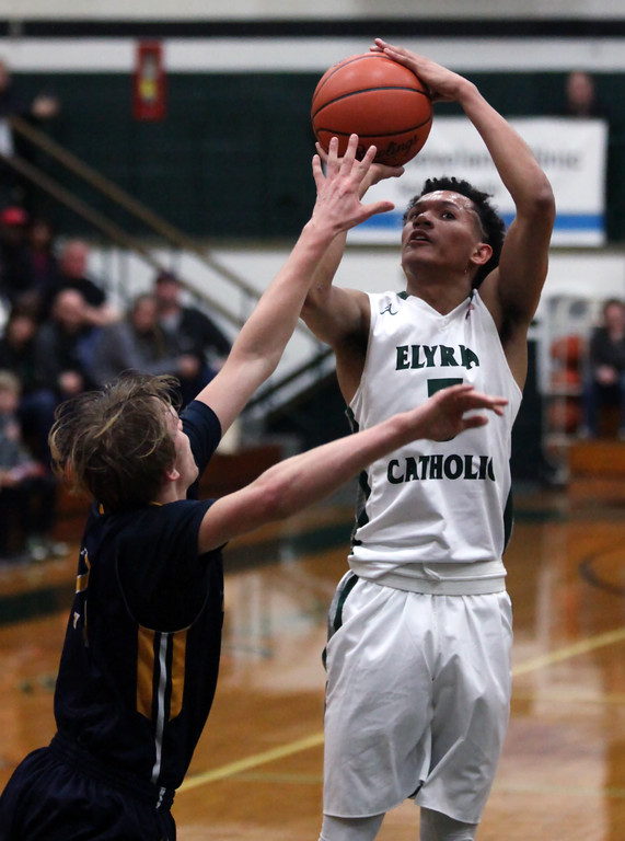 . Elyria Catholic\'s Dorian Crutcher hits the jump shot for two over Dallas Zollars of Wickliffe during the second quarter. Randy Meyers -- The Morning Journal