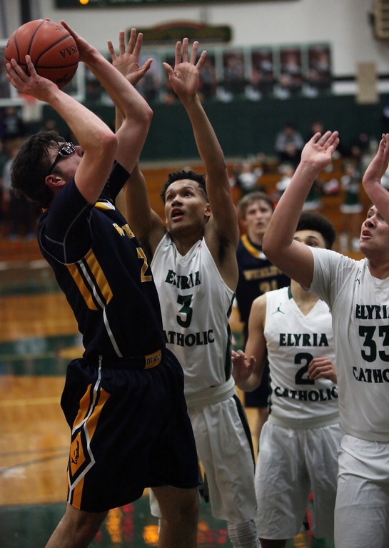 . Josh Perpar of Wickliffe shoots over Dorian Crutcher of Elyria Catholic during the third quarter. Randy Meyers -- The Morning Journal