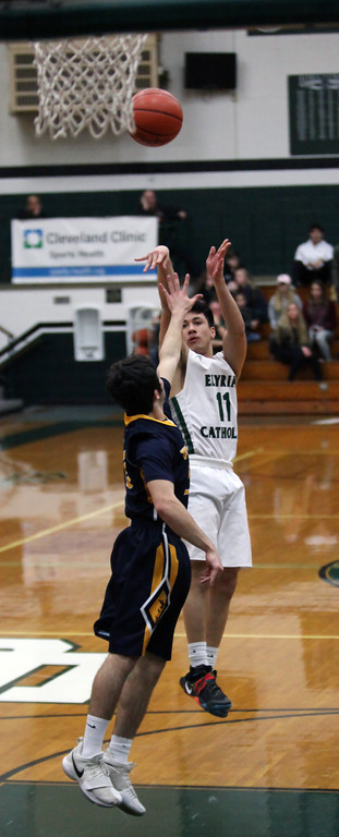 . Elyria Catholic guard David Griffin shoots a jumper over Nick Colbert of Wickliffe during the second quarter. Randy Meyers -- The Morning Journal