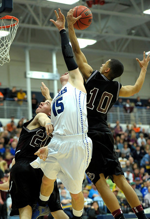 Broomfield's Evan Kihn (middle) looses a rebound to Golden's Nate Hill (right) and Shawn McClain (left) during their basketball game at the Colorado School of Mines in Golden, Colorado March 2, 2012. CAMERA/MARK LEFFINGWELL