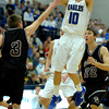 Broomfield's Ausitn Wood (right) gets a shot off over Golden's Jordan Johnson (left) during their basketball game at the Colorado School of Mines in Golden, Colorado March 2, 2012. CAMERA/MARK LEFFINGWELL