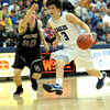 Broomfield's Nick Ongarato (right) is pressured by Golden's Shawn McClain (left) during their basketball game at the Colorado School of Mines in Golden, Colorado March 2, 2012. CAMERA/MARK LEFFINGWELL