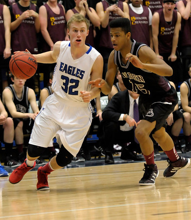Broomfield's Colin Jensen (left) is pressured by Golden's Leonard Holland (right) during their basketball game at the Colorado School of Mines in Golden, Colorado March 2, 2012. CAMERA/MARK LEFFINGWELL