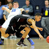 Broomfield's Evan Kihn (left) draws a foul from Golden's Nate Hill (right) during their basketball game at the Colorado School of Mines in Golden, Colorado March 2, 2012. CAMERA/MARK LEFFINGWELL