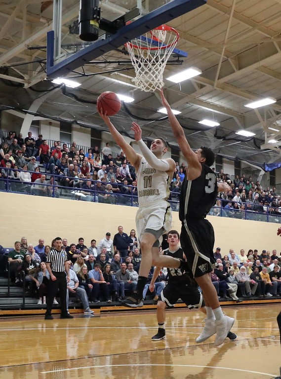 . Tim Phillis - The News-Herald Photos from the John Carroll vs. Wooster men\'s basketball Division III NCAA tournament game on March 3, 2018.