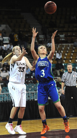 "Legacy High's Courtney Smith (33) battles Doherty High's Kim Cerjn (3) during their game at the Denver Coliseum on Saturday March 3, 2012.<br /> Photo by Paul Aiken / The Daily Camera /  <a href=""http://www.bocopreps.com"">http://www.bocopreps.com</a>"