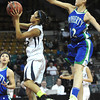 "Legacy High's Kailey Edwards (22) shoots Doherty High's Danielle Santos (12) defends during their game at the Denver Coliseum on Saturday March 3, 2012.<br /> Photo by Paul Aiken / The Daily Camera /  <a href=""http://www.bocopreps.com"">http://www.bocopreps.com</a>"