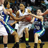 "Legacy High's Kailey Edwards (22) dribbles through traffic as  Doherty High's Angela Vigil (20) defends during their game at the Denver Coliseum on Saturday March 3, 2012.<br /> Photo by Paul Aiken / The Daily Camera /  <a href=""http://www.bocopreps.com"">http://www.bocopreps.com</a>"
