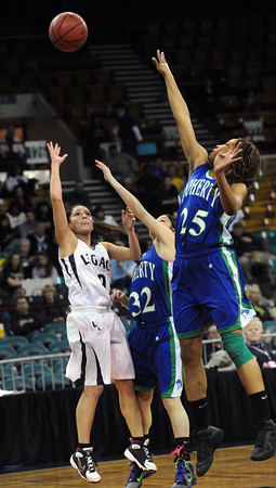 """Legacy High's Emiley Lopez (10)shoots as Doherty High's Laurin Rivera (32) and Aisha Harris (25) defend during their game at the Denver Coliseum on Saturday March 3, 2012.<br /> Photo by Paul Aiken / The Daily Camera /  <a href=""""http://www.bocopreps.com"""">http://www.bocopreps.com</a>"""