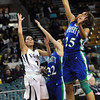 "Legacy High's Emiley Lopez (10)shoots as Doherty High's Laurin Rivera (32) and Aisha Harris (25) defend during their game at the Denver Coliseum on Saturday March 3, 2012.<br /> Photo by Paul Aiken / The Daily Camera /  <a href=""http://www.bocopreps.com"">http://www.bocopreps.com</a>"