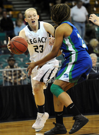 """Legacy High's Caitlyn Smith (23) passes around Doherty High's Aisha Harris (25) during their game at the Denver Coliseum on Saturday March 3, 2012.<br /> Photo by Paul Aiken / The Daily Camera /  <a href=""""http://www.bocopreps.com"""">http://www.bocopreps.com</a>"""