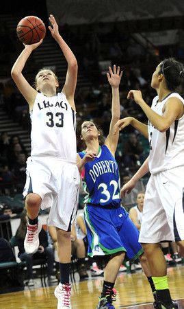 """Legacy High's Courtney Smith  (33) shoots over Doherty High's Aurin Rivera  (32) during their game at the Denver Coliseum on Saturday March 3, 2012.<br /> Photo by Paul Aiken / The Daily Camera /  <a href=""""http://www.bocopreps.com"""">http://www.bocopreps.com</a>"""