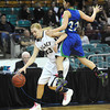"Legacy High's Courtney Smith  (33)  dribbles past Doherty High's Laurin Rivera (32) during their game at the Denver Coliseum on Saturday March 3, 2012.<br /> Photo by Paul Aiken / The Daily Camera /  <a href=""http://www.bocopreps.com"">http://www.bocopreps.com</a>"