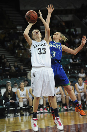 """Legacy High's Courtney Smith  (33) shoots as Doherty High's Kim Cerajn (3) defends during their game at the Denver Coliseum on Saturday March 3, 2012.<br /> Photo by Paul Aiken / The Daily Camera /  <a href=""""http://www.bocopreps.com"""">http://www.bocopreps.com</a>"""