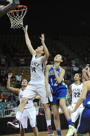 """Legacy High's Shayna Kuyper (14) shoots over Doherty High's Danielle Santos (12)  during their game at the Denver Coliseum on Saturday March 3, 2012.<br /> Photo by Paul Aiken / The Daily Camera /  <a href=""""http://www.bocopreps.com"""">http://www.bocopreps.com</a>"""