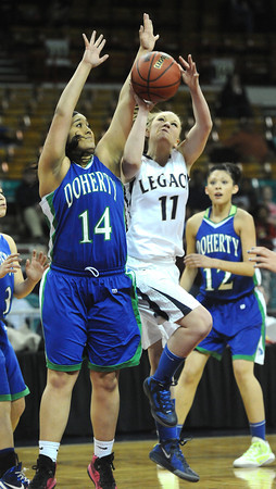 """Legacy High's Emily Glen (11) and Doherty High's Bri Daniels (14) battle under the basket during their game at the Denver Coliseum on Saturday March 3, 2012.<br /> Photo by Paul Aiken / The Daily Camera /  <a href=""""http://www.bocopreps.com"""">http://www.bocopreps.com</a>"""