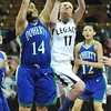 "Legacy High's Emily Glen (11) and Doherty High's Bri Daniels (14) battle under the basket during their game at the Denver Coliseum on Saturday March 3, 2012.<br /> Photo by Paul Aiken / The Daily Camera /  <a href=""http://www.bocopreps.com"">http://www.bocopreps.com</a>"