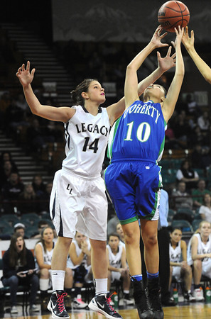 "Legacy High's Shayna Kuyper (14) battles with Doherty High's Shalisa Mofitt (10) during their game at the Denver Coliseum on Saturday March 3, 2012.<br /> Photo by Paul Aiken / The Daily Camera /  <a href=""http://www.bocopreps.com"">http://www.bocopreps.com</a>"