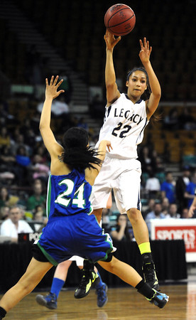 """Legacy High's Kailey Edwards (22) passes over Doherty High's Vanessa Villagrana (24)  during their game at the Denver Coliseum on Saturday March 3, 2012.<br /> Photo by Paul Aiken / The Daily Camera /  <a href=""""http://www.bocopreps.com"""">http://www.bocopreps.com</a>"""