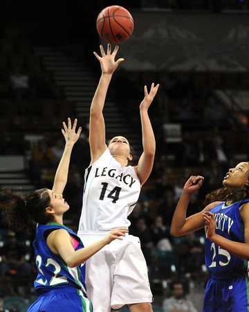 """Legacy High's Shayna Kuyper (14) shoots over Doherty High's Laurin Rivera (32) during their game at the Denver Coliseum on Saturday March 3, 2012.<br /> Photo by Paul Aiken / The Daily Camera /  <a href=""""http://www.bocopreps.com"""">http://www.bocopreps.com</a>"""