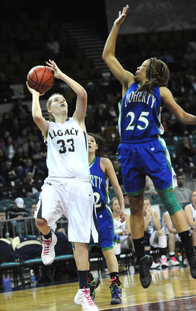 "Legacy High's Courtney Smith  (33) shoots as Doherty High's Aisha Harris (25) defends during their game at the Denver Coliseum on Saturday March 3, 2012.<br /> Photo by Paul Aiken / The Daily Camera /  <a href=""http://www.bocopreps.com"">http://www.bocopreps.com</a>"