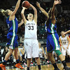 "Legacy High's Courtney Smith  (33) shoots as Doherty High's Kim Cerajn (3) and Aisha Harris (25) defend during their game at the Denver Coliseum on Saturday March 3, 2012.<br /> Photo by Paul Aiken / The Daily Camera /  <a href=""http://www.bocopreps.com"">http://www.bocopreps.com</a>"