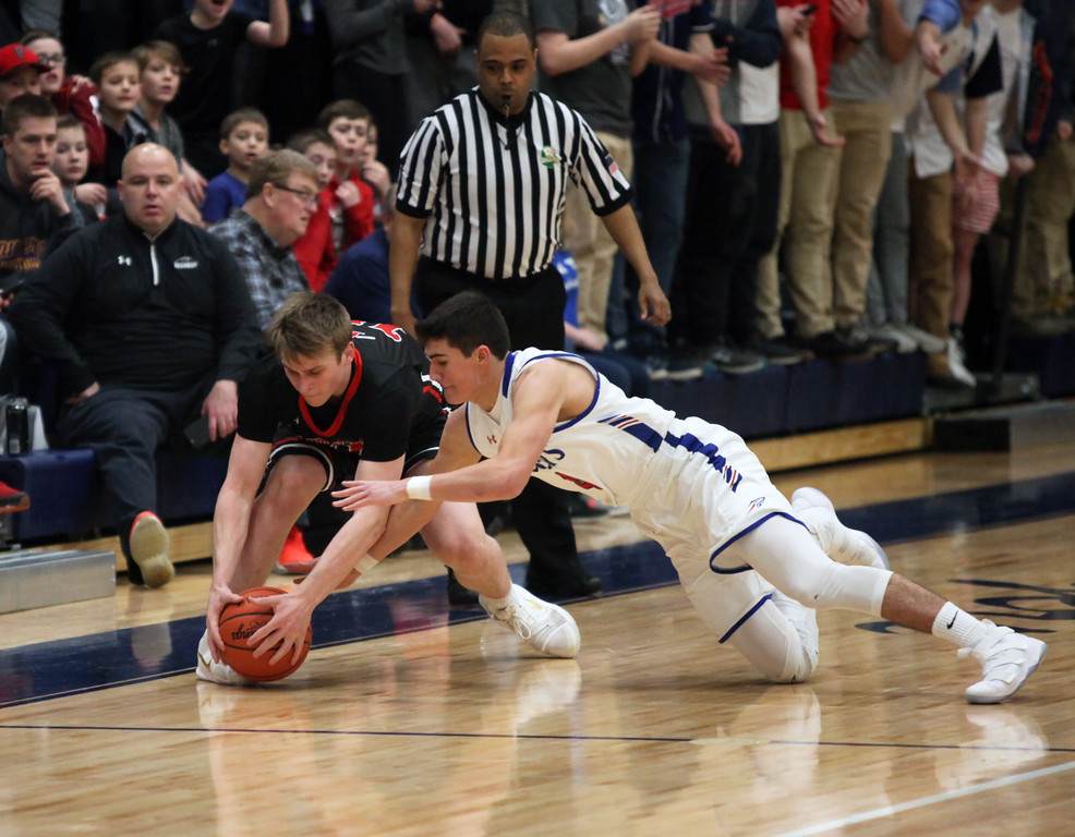. Fairview\'s Luke Howes and Bay\'s Max Showalter dive after a loose ball near the sideline during the third quarter. Randy Meyers -- The Morning Journal