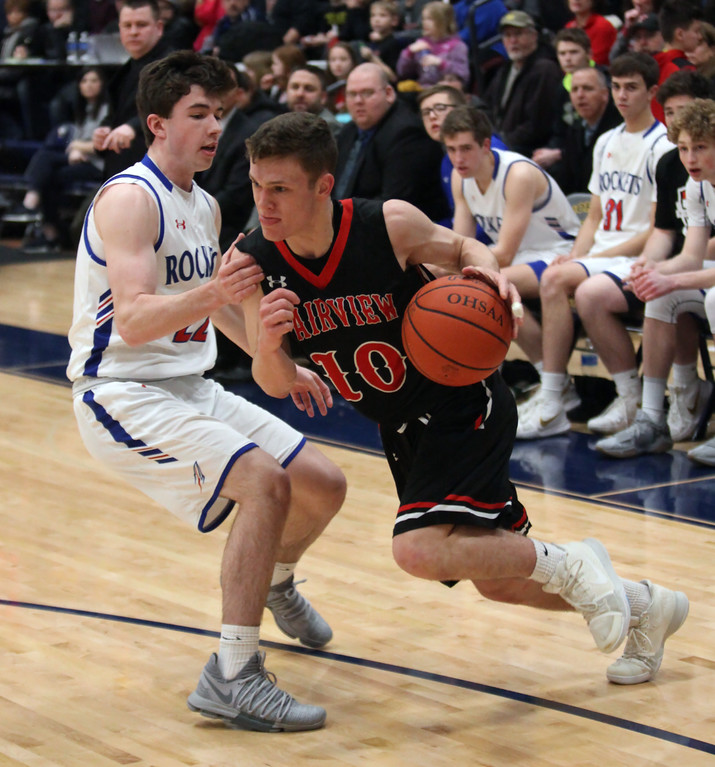 . Fairview guard Grant Howes drives past Brent Hull of Bay along the baseline during the second quarter. Randy Meyers -- The Morning Journal