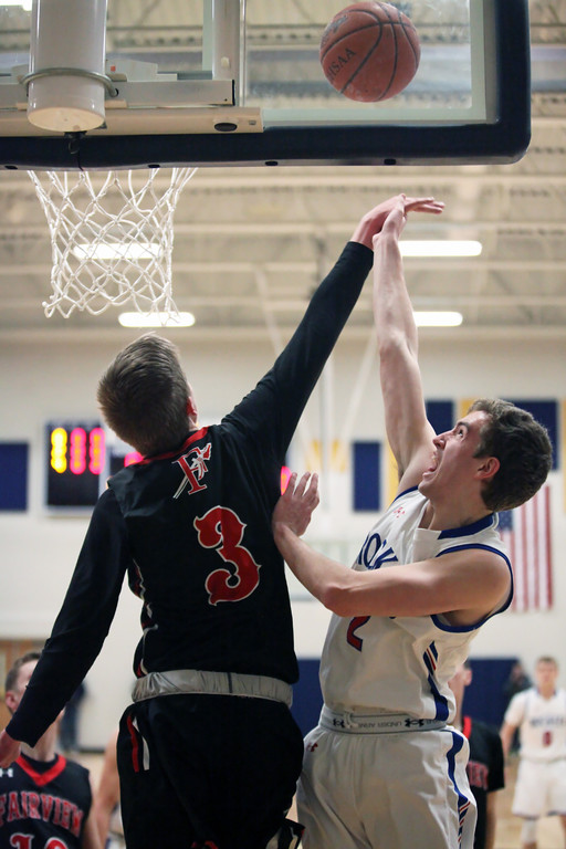 . Bay\'s Daniel Brajdic is fouled on the shot by Colin Caja of Fairview during the first quarter. Randy Meyers -- The Morning Journal