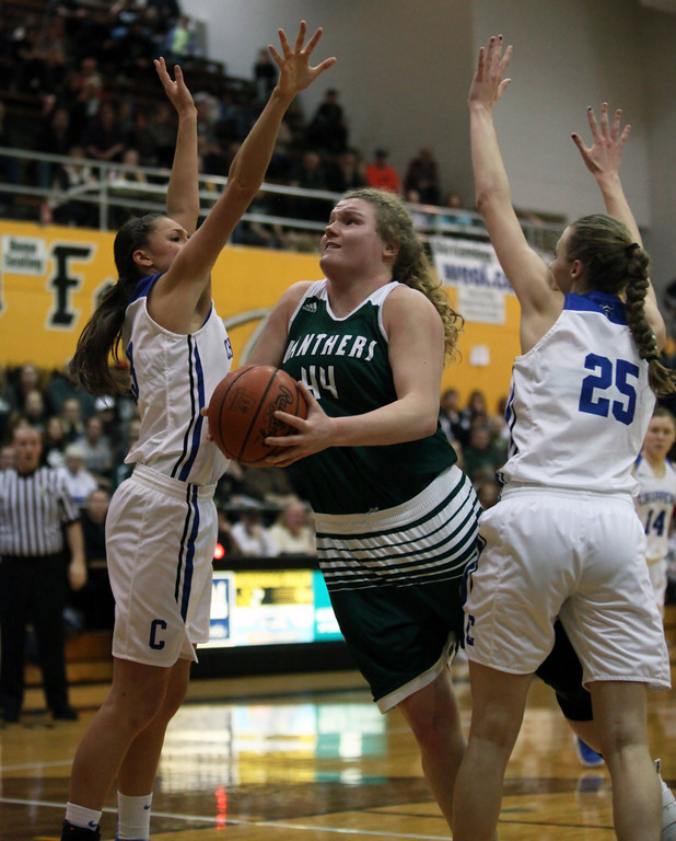 . Ally Winnen of Elyria Catholic drives in between Celina Koncz and Grace Lindquist of Chippewa during the second quarter. Randy Meyers -- The Morning Journal